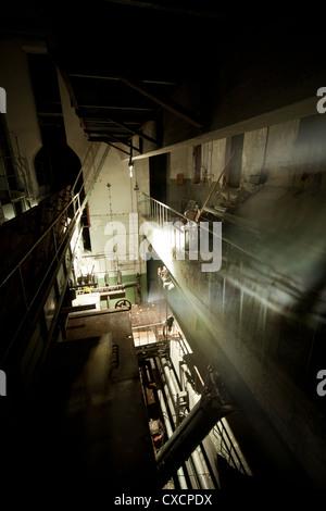 Abandoned power station, 3rd level at night - Stock Image
