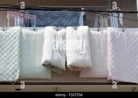 Hang dry laundry futon Japan - Stock Image