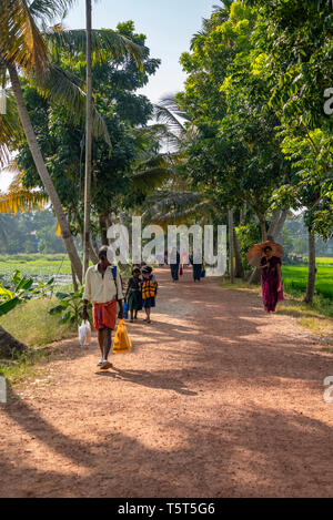 Vertical view of people walking along the riverbank in Alleppy, India - Stock Image