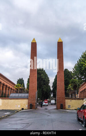 Egyptian Revival brick obelisks at the entrance of Terre Cabade cemetery, 1840, Toulouse, Occitanie, France - Stock Image