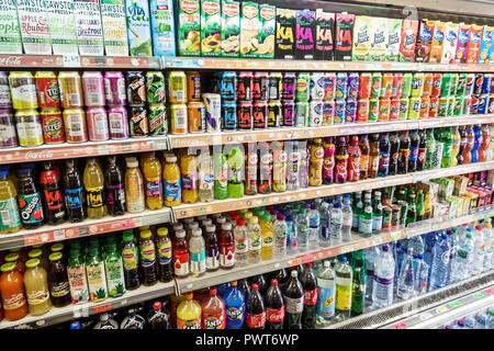 London England United Kingdom Great Britain Lambeth market grocery convenience store soda beverages soft drinks cans bottles Coca-Cola fruit juice Fan - Stock Image