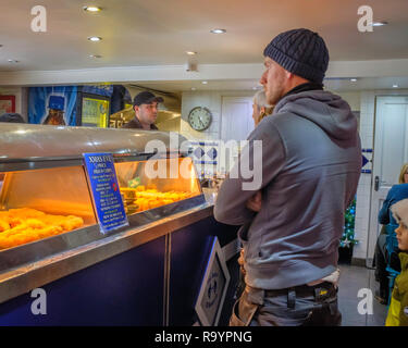 Inside a fish and chip shop. - Stock Image