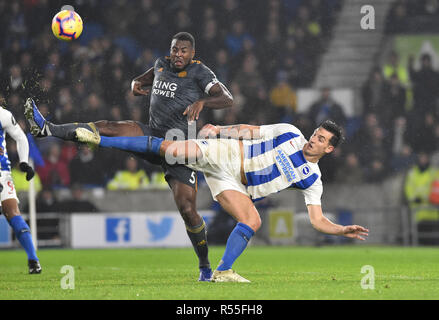Lewis Dunk of Brighton battles for the ball with Wes Morgan of Leicester during the Premier League match between Brighton and Hove Albion and Leicester City at American Express Community Stadium , Brighton , 24 November 2018 Editorial use only. No merchandising. For Football images FA and Premier League restrictions apply inc. no internet/mobile usage without FAPL license - for details contact Football Dataco - Stock Image
