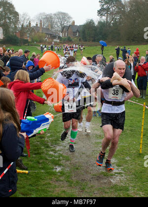 Dorking, UK. 8th April, 2018. The 11th UK Wife Carrying Race takes place at The Nower, Dorking, Surrey, UK. 10.30am Sunday 8 April 2018. Photo by ©Lindsay Constable/Alamy Live News - Stock Image