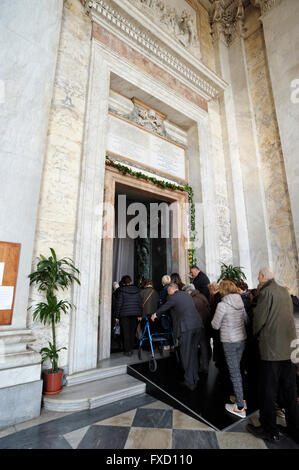 italy, rome, basilica of san giovanni in laterano, jubilee 2016, pilgrims passing through the open holy door - Stock Image