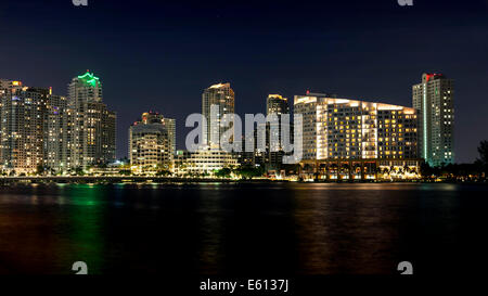 Miami's Brickell Key night skyline featuring the Mandarin Oriental Hotel sparkles from across Biscayne Bay. - Stock Image