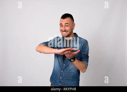 Full length portrait of a happy smiling man - Stock Image