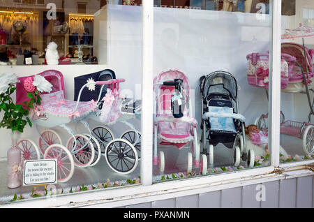 Window display of  Doll's prams desirable toys for young girls - Stock Image
