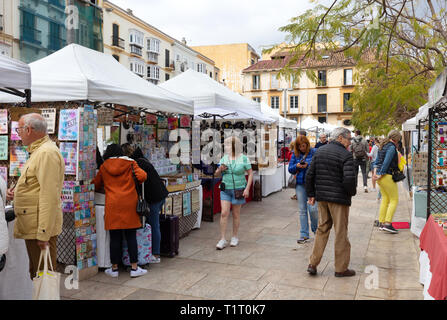 Malaga Spain; local people shopping at the outdoor street market stalls, Plaza de la Merced, Malaga old town, Andalusia, Spain, - Stock Image