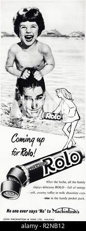 Original 1950s vintage old print advertisement from English magazine advertising Mackintosh's Rolo chocolates circa 1954 - Stock Image