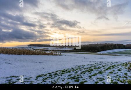 View towards Cheesefoot Head on the South Downs Way during sunset in winter 2019, South Downs National Park, England, UK - Stock Image