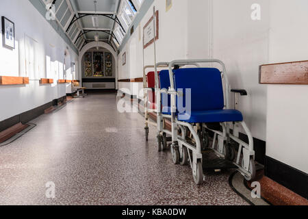 Wheelchairs parked in a hospital corridor. - Stock Image