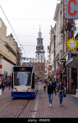 Tourists at Reguliersbreestraat street with the Munttoren tower in the background, Amsterdam, Netherlands - Stock Image