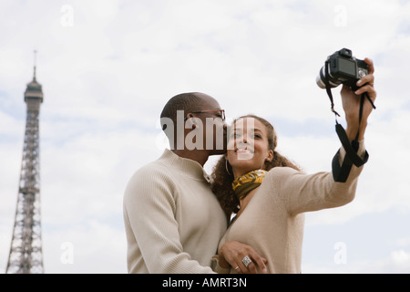 African couple taking own photograph - Stock Image