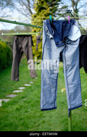 Jeans hung dry - Stock Image