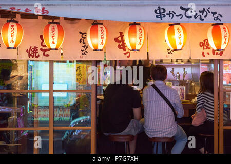 Facade of grilled chicken restaurant in the area of Shinjuku, central Tokyo, Japan. - Stock Image