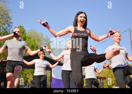 Nis, Serbia - April 20, 2019 Piloxing sport training group of people on sunny spring day outdoor with instructor - Stock Image