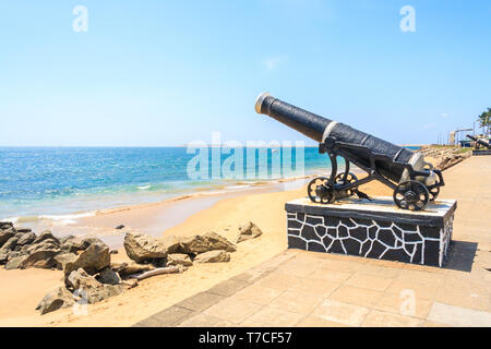 Colombo, Sri Lanka - March 16th 2011: Guns on the promenade at Galle Face. The promenade and green behind are popular relaxation places. - Stock Image