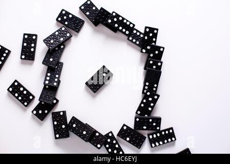 Dominoes falling - Stock Image