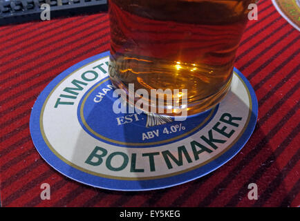 A pint of Timothy Taylor Boltmaker Bitter, in a bar, Yorkshire, England, UK on a beermat - Stock Image