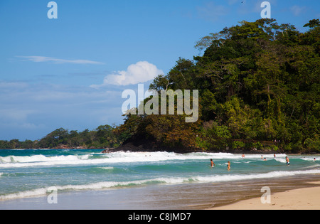 Holidaymakers in the surf at Playa Red Frog. - Stock Image