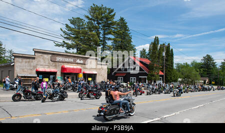 A large group of motorcycle riders touring the Adirondack Mountains in Speculator, NY USA - Stock Image