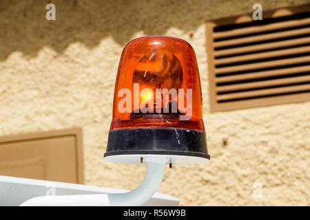 flashing emergency light siren mounted on a car - Stock Image