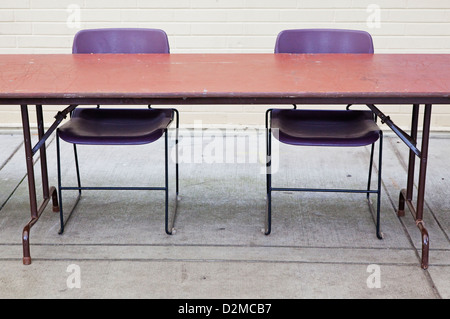 table and chairs set up outside - Stock Image