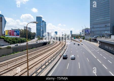 Israel, Tel Aviv-Yafo - 20 April 2019: Ayalon highway and Tel Aviv HaShalom railway station - Stock Image