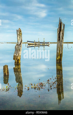 A calm high tide at Thornham. - Stock Image