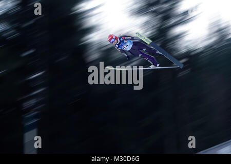 Juliane Seyfarth, Germany, on her first ski-jump for qualification for World Championship in Ski Jumping for women. - Stock Image