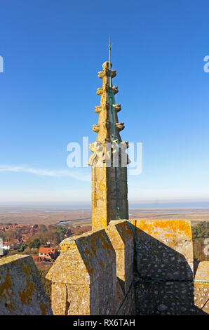 A pinnacle on the lofty tower of the parish Church of St Nicholas at Blakeney, Norfolk, England, United Kingdom, Europe. - Stock Image