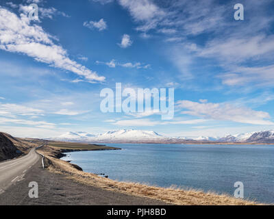 The Iceland Ring Road in North Iceland, near Akureyri, beside Eyjafjordur Fjord. - Stock Image