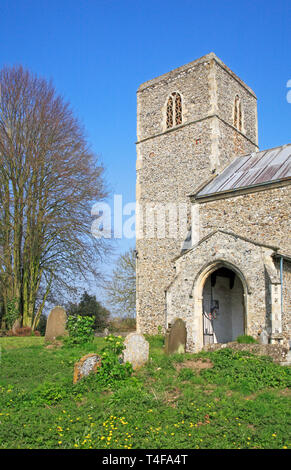 A view of the tower and south porch of the parish Church of St Margaret at Cantley, Norfolk, England, United Kingdom, Europe. - Stock Image