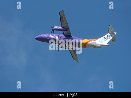 Flyby Saab 2000 Civil Airliner departing Inverness Dalcross Airport for Manchester. - Stock Image