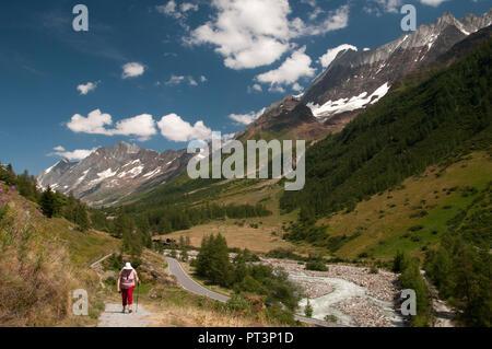 Walking in the upper Loetschental valley, Valais, Switzerland - Stock Image