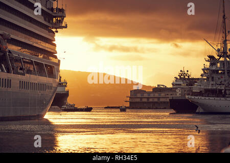 Ferry in port at sunset - Stock Image
