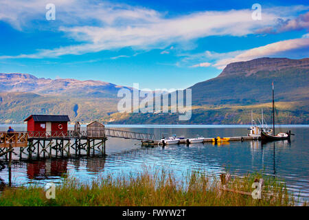 A traditional wooden Nordland boat is moored at a jetty in Foldvik at Gratangen fjord  northern Norway. - Stock Image