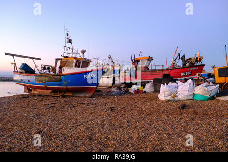 Hastings East Sussex, UK. 1st Jan, 2019. Lone fisherman sorts his nets at dawn on New Year's Day. Hastings with 25 working boats has one of the largest beach launched fishing boat fleets in Europe. - Stock Image