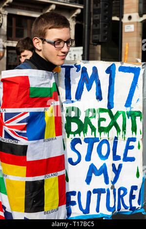 London, UK. 23 March 2019. Teenager worried about his future. Remain supporters and protesters take part in a march to stop Brexit in Central London calling for a People's Vote. - Stock Image