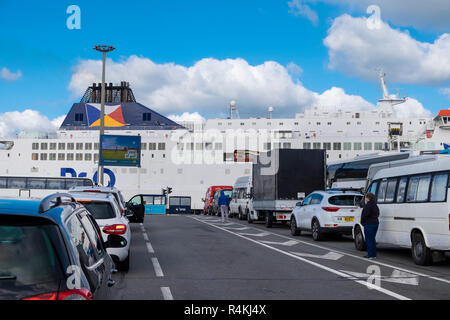 Vehicles waiting to board a ferry at Calais, France - Stock Image