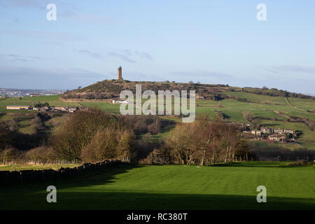 The Victoria Tower on Castle Hill in Almondbury, Huddersfield viewed from Farnley Tyas - Stock Image