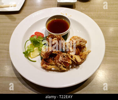 Soft shelled crab served deep fried in a sushi restaurant - Stock Image