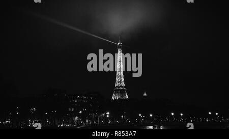 Paris, France -Dec 2, 2018: Illuminated Eiffel Tower at night in monochrome - Stock Image