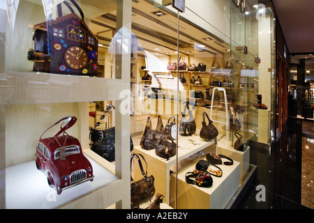 Dubai Mall of Emirates shopping mall shop window for luxery woman hand bags in form of a car or a cuckoo clock - Stock Image