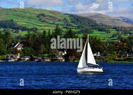 A small yacht on lake Windermere,Cumbria,England,UK - Stock Image
