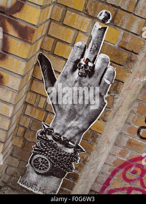 Berlin Mitte,Street art on walls,Germany,watch,arm,extended middle finger - Stock Image