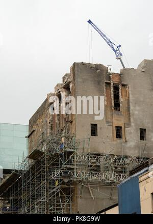 Work continues to secure the west and south walls of Charles Rennie Mackintosh's Glasgow school of art which was damaged by fire in June, 2018. - Stock Image