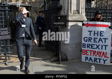 On the day that MPs in Parliament vote on a possible delay on Article 50 on EU Brexit negotiations by Prime Minister Theresa May, Brexiteer activists protest at the gates of the House of Commons, on 14th March 2019, in Westminster, London, England. - Stock Image