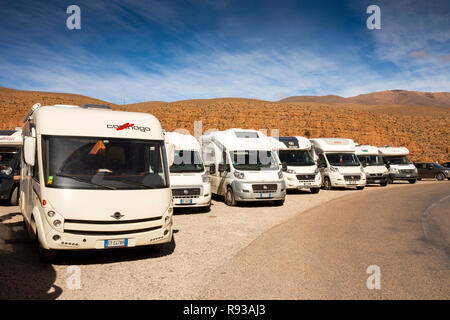 Morocco, Dades Gorge, group of Italian motorhomes occupying entire viewpoint parking area - Stock Image